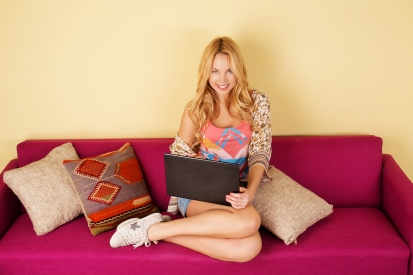 Pretty young woman using her laptop