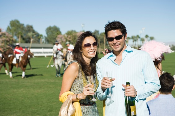 Couple Celebrating with Champagne at a Polo Match